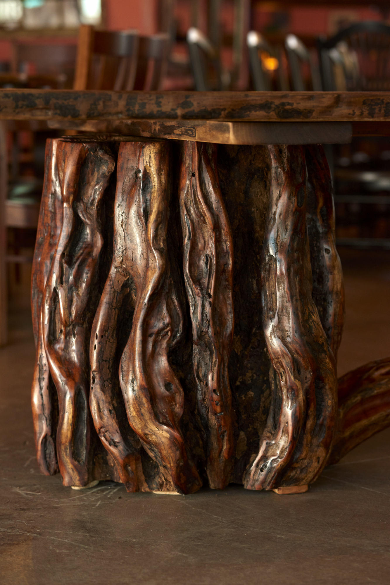Rustic Furniture Photography of hand made table created from a large mesquite stump.
