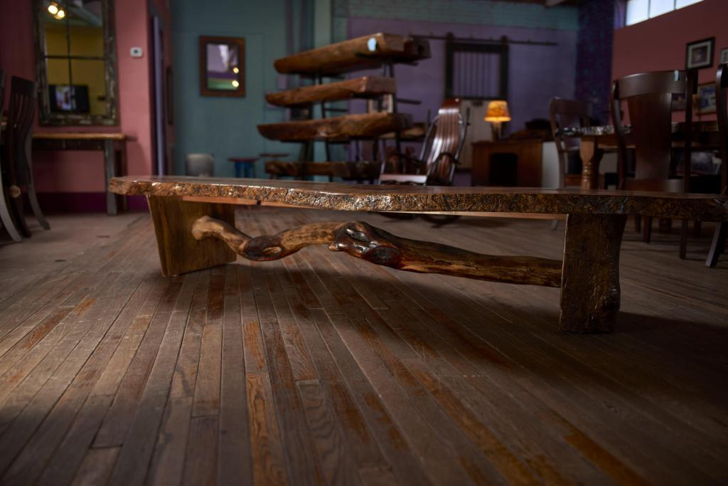 Rustic Furniture Photography of a pecan bench with log spreader.