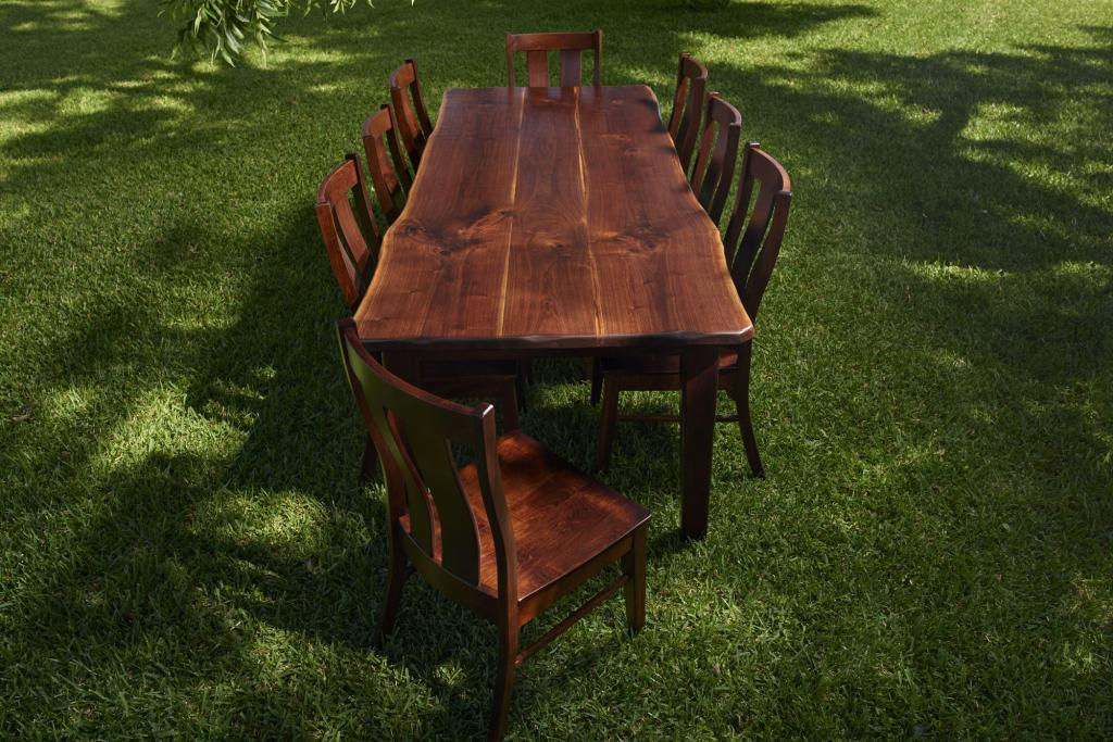 Rustic Furniture Photography of a large farm table with omish chairs.