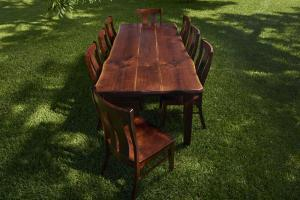 Rustic Furniture Product Photography of a large farm table with omish chairs.