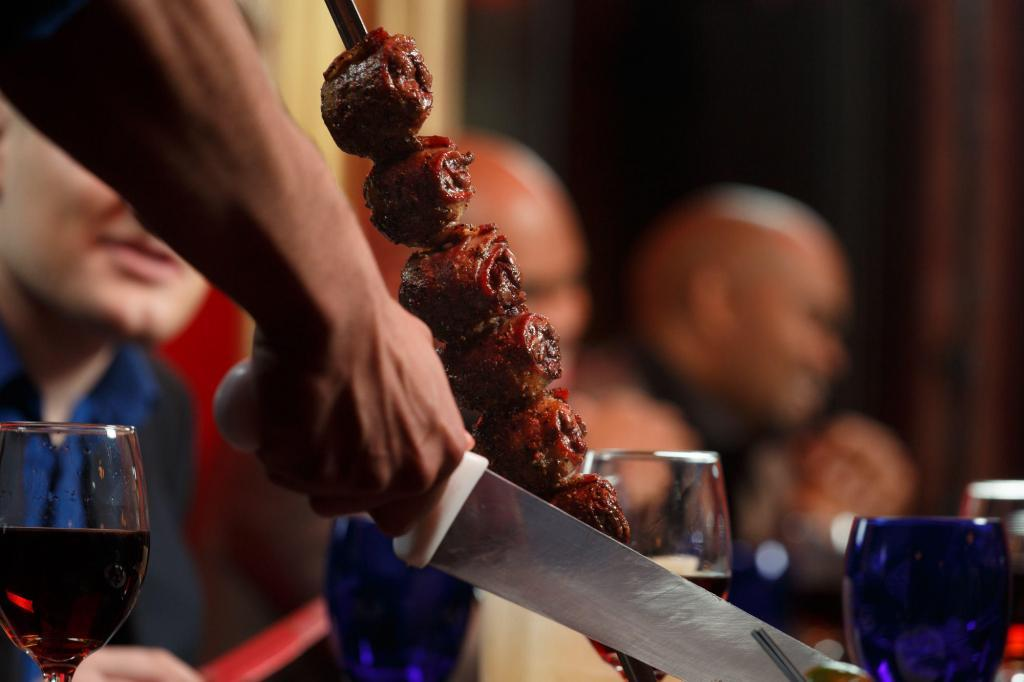 Texas De Brazil Waiter Carving Meat During a Commercial Lifestyle Restaurant Photography Shoot
