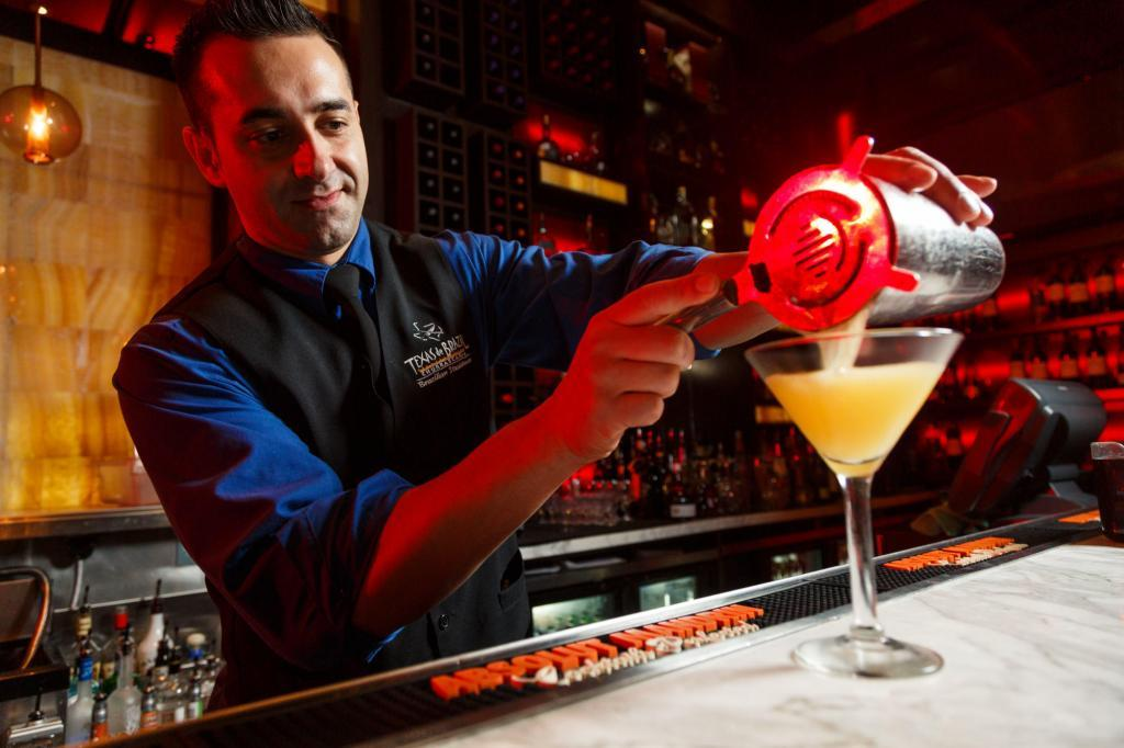 Texas De Brazil bartender pouring a drink during a Commercial Lifestyle Restaurant Photography Shoot.