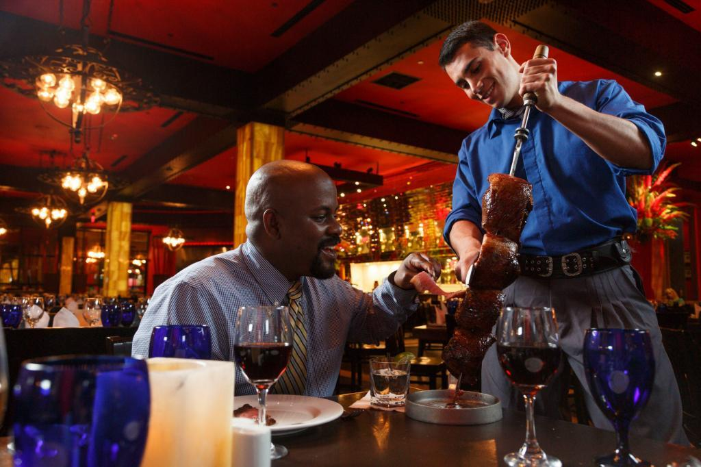 Texas De Brazil Guests are served by waiters during Commercial Lifestyle Restaurant Photography Shoot