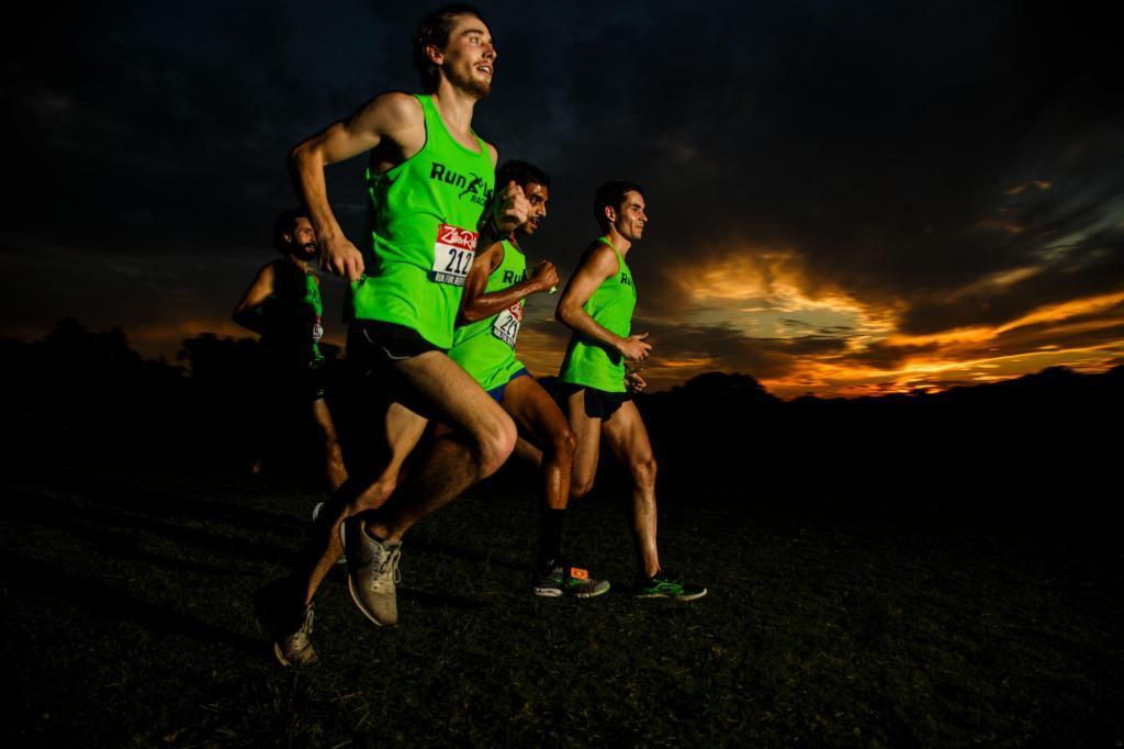 The Run Labs Relay Team running after sunset - Zilker Relay Race Photorgaphy