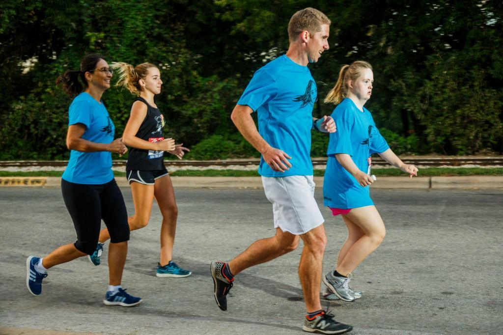 The Run Labs and Empowered Coffee Team Run Along Side of the Kayleigh's Club Running Team