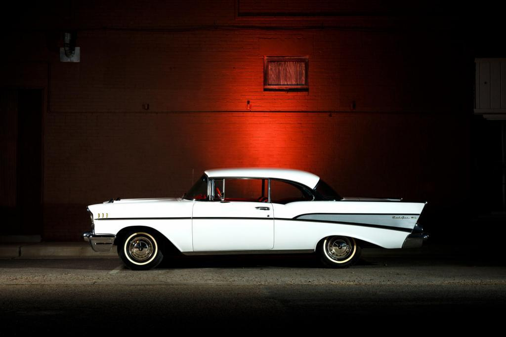 Classic 1956 Chevy Bel Air against small town brick wall with red light. Josh Baker Central Texas Automotive Photography
