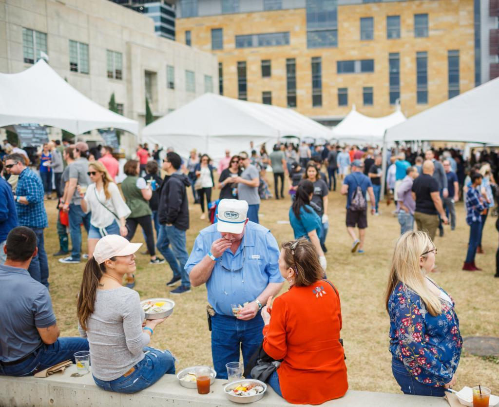 Crowds enjoying oysterfest on Seaholm Lawn at the old power plant - Austin event photography.