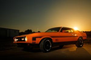 Sunset behind a 1977 Ford Mustang, Mach 1 in central Texas.