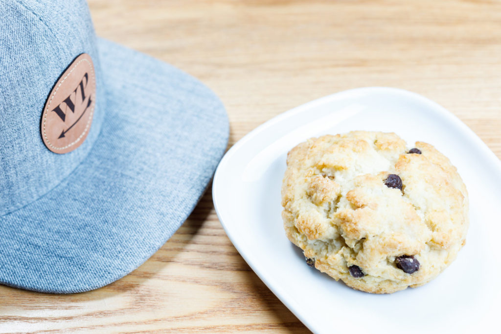West Pecan Coffee + Beer Scone and custom baseball cap - Commercial Food Photography - Detailed Food Photos for an online menu.