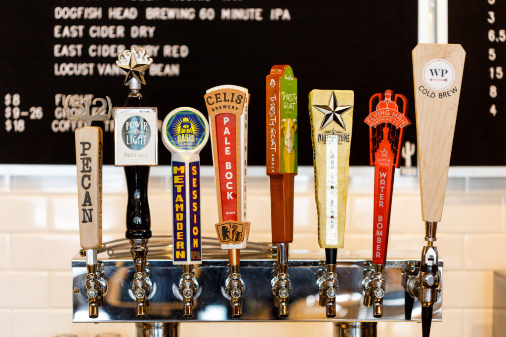 West Pecan Coffee + Beer - Beers on Tap next to their in house Cold Brew tap - Online menu photography.