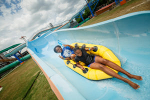 Enjoying a splash in the water park at ZDT in Seguin - Amusement Park Marketing Photography
