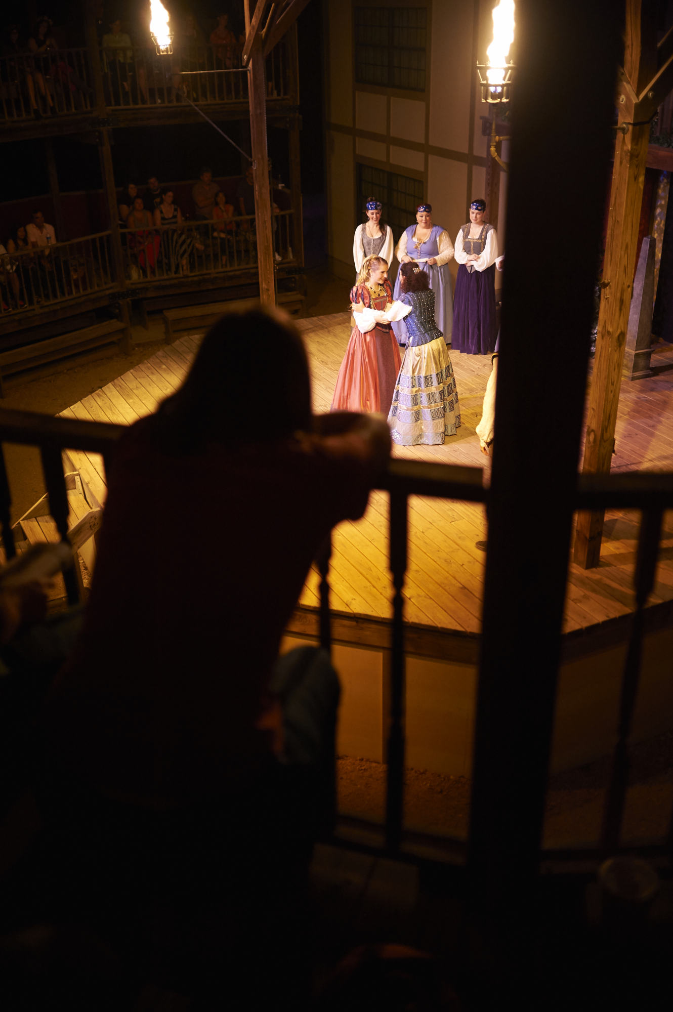 A guest avidly watches Beatrice and Hero on stage at the Curtain Theater in Austin.