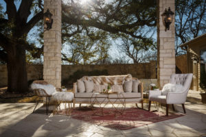 Design photography for events. Photography of stylish couches and accents on a stone patio.