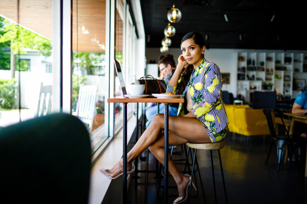 Haide sits at the laptop bar at West Pecan Coffee + Beer in Pflugerville, Tx during her Personal Branding Session.