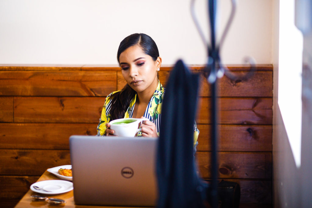 Haide works on her laptop at West Pecan Coffee + Beer in Pflugerville, Tx during her Personal Branding Session.