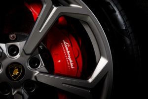 Front brake caliper and wheel detail automotive photo from a 2019 Lamborghini Uras for sale at Silicon Auto Group in Austin Texas.